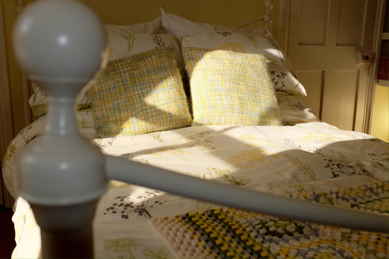 Crochet blanket and botanical bed linen