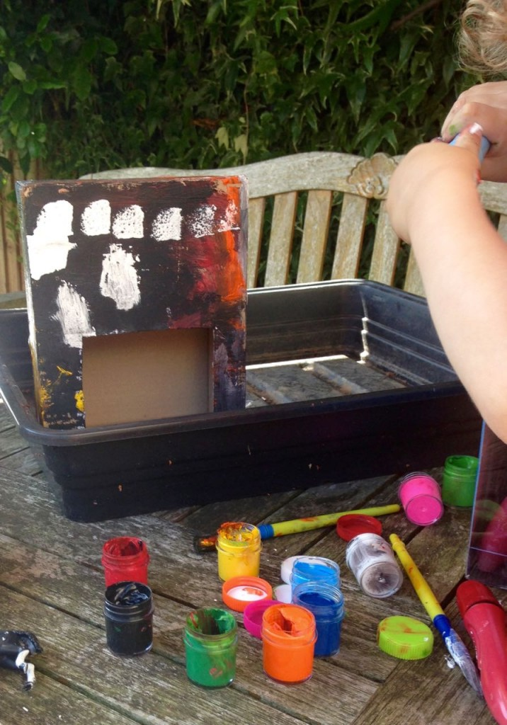 painting a cardboard stable