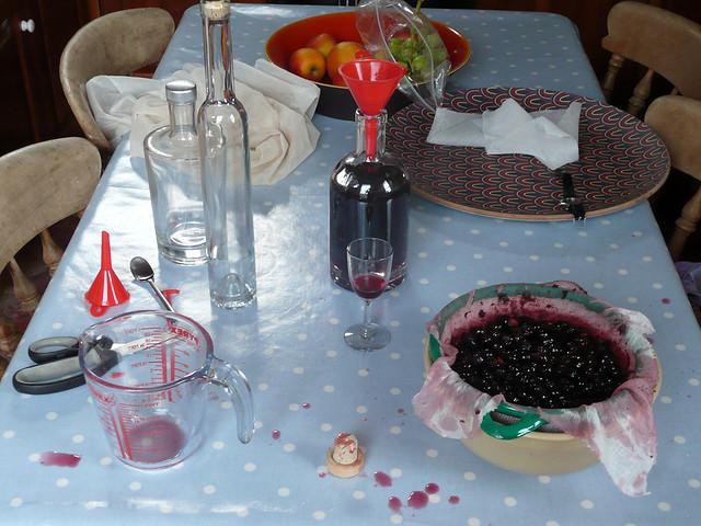 Straining and bottling sloe gin