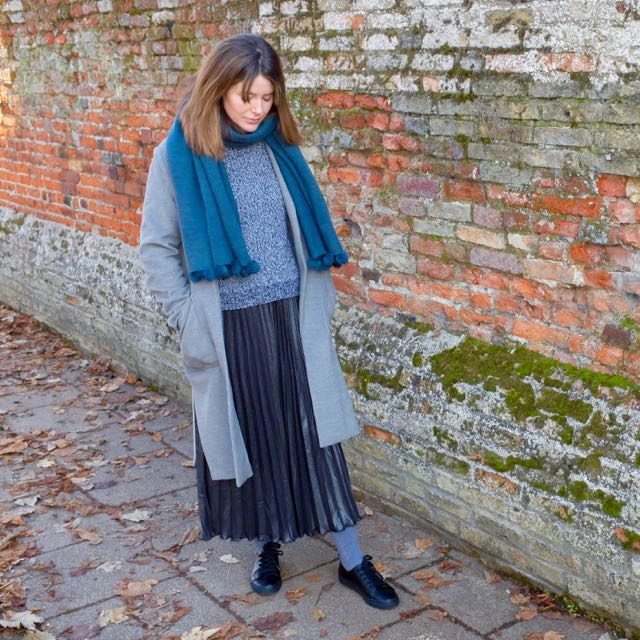 Pleated skirt and woolly jumper