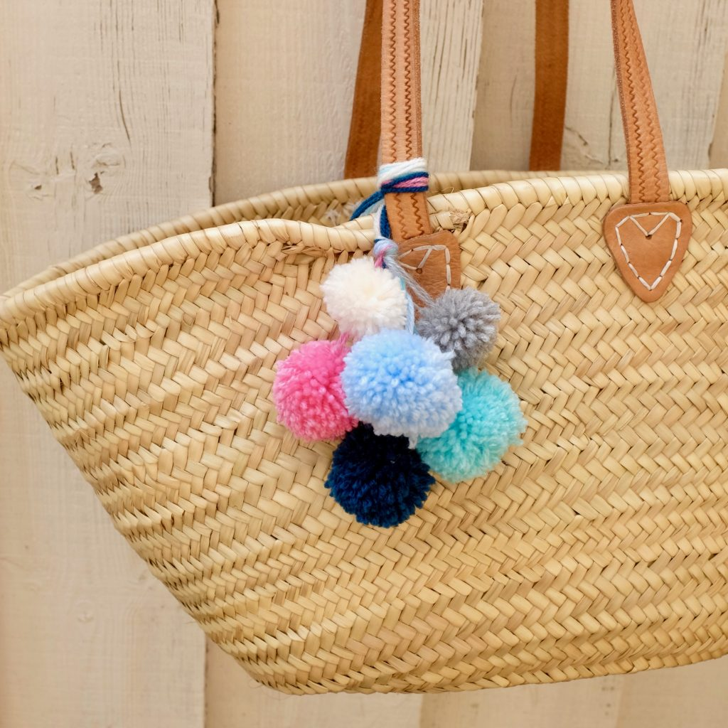 Have a go at making your own pom pom accessories.