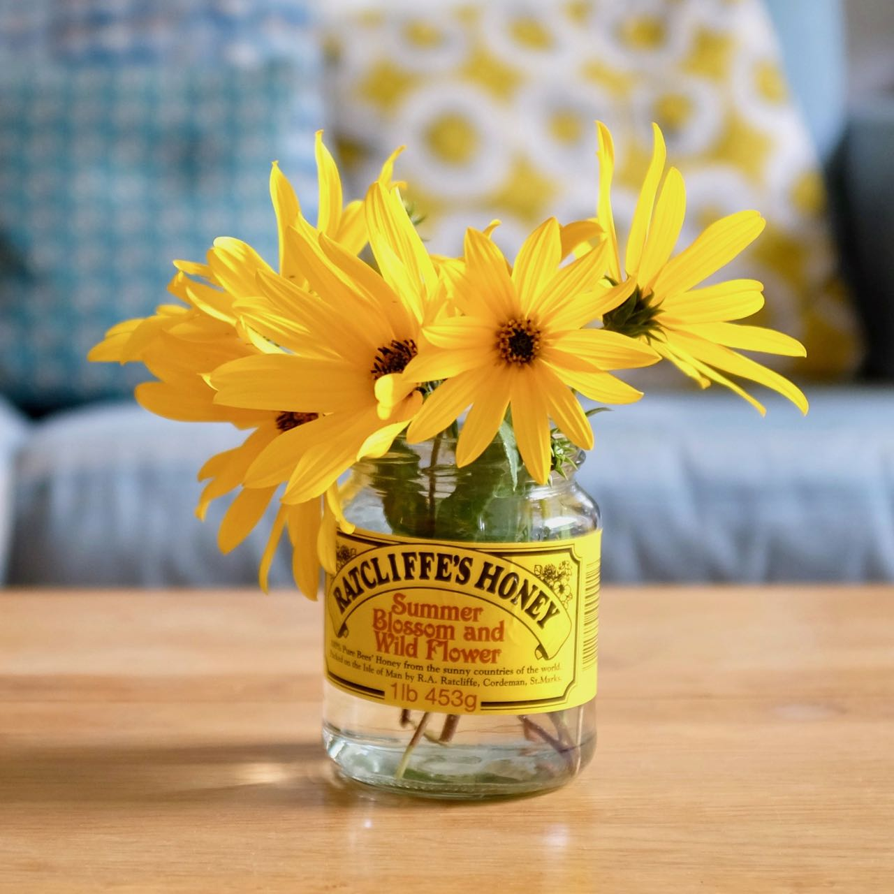 Yellow flowers in a jam jar