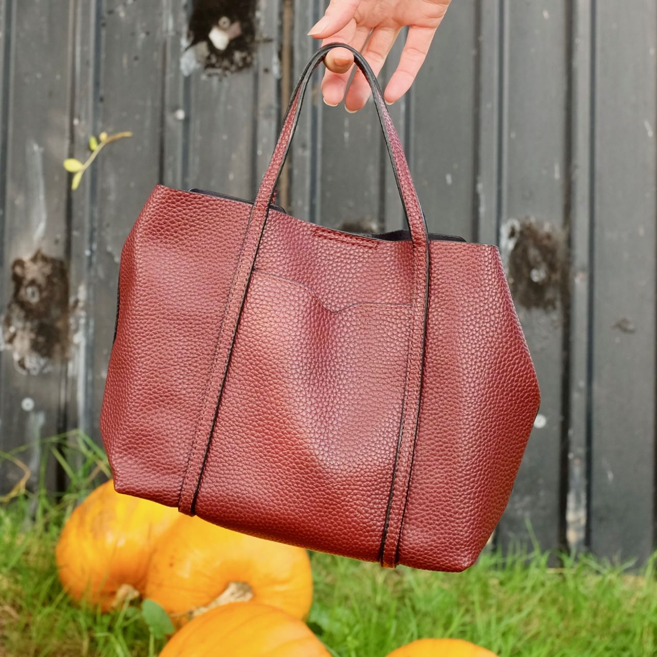 Oxblood handbag by Mango