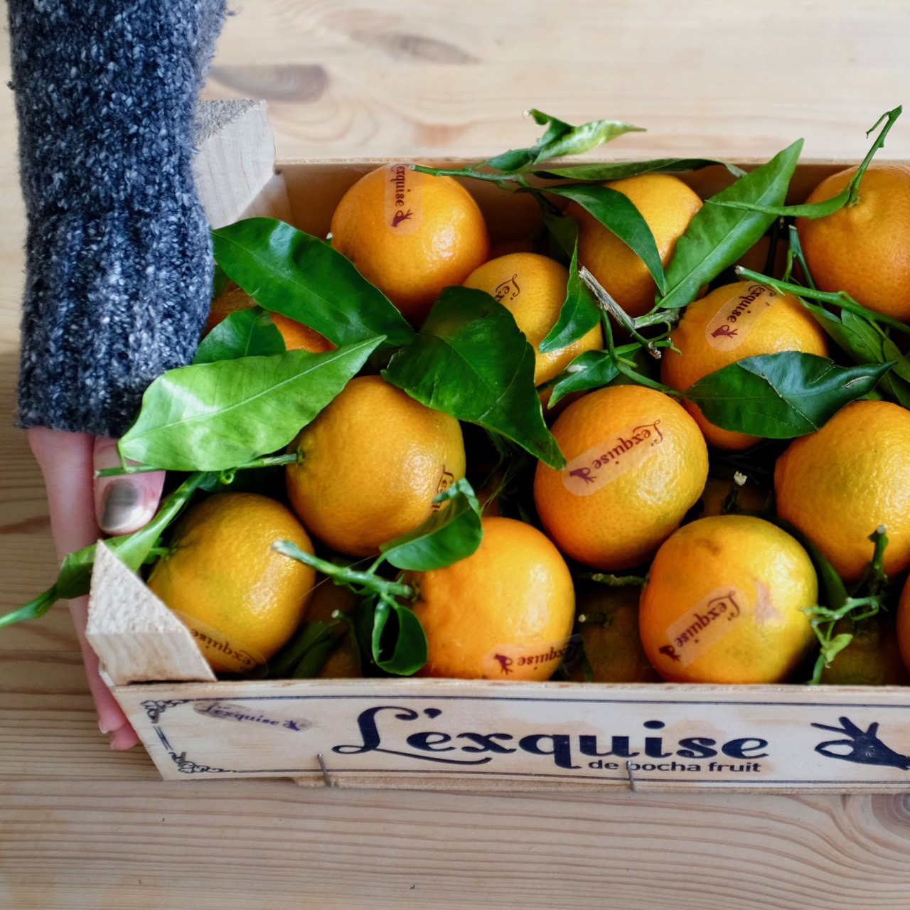 Wooden crate of clementines