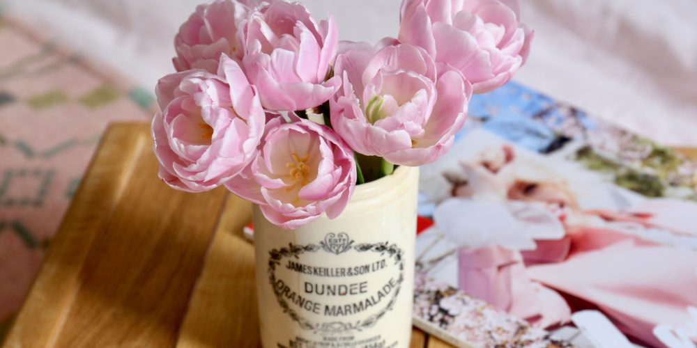 The Weekend Edit: reading a magazine in bed with tulips