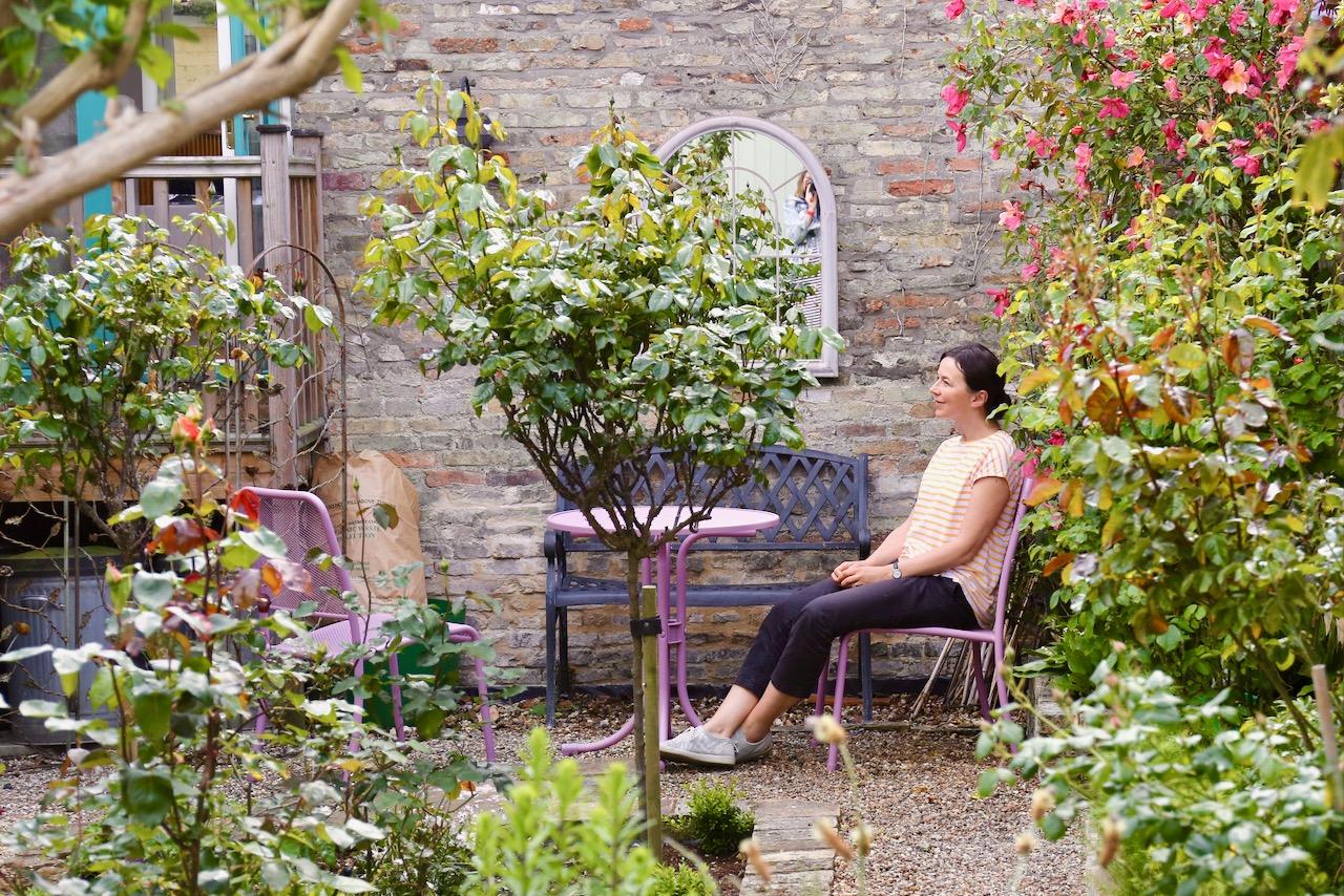 Melanie Goemans, artist, in her garden